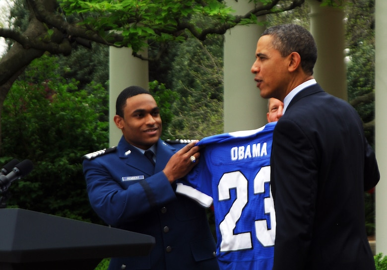 President Barack Obama receives a Falcons jersey with the same number he wore on his high school basketball jersey from defensive back Reggie Rembert after presenting the 2010 Air Force Academy football team with the Commander-in-Chief's Trophy at the White House Monday, April 18, 2011.  This is the 17th time the Falcons have won the trophy and the first since 2002.  (U.S. Air Force photo/Staff Sgt. Raymond Hoy)