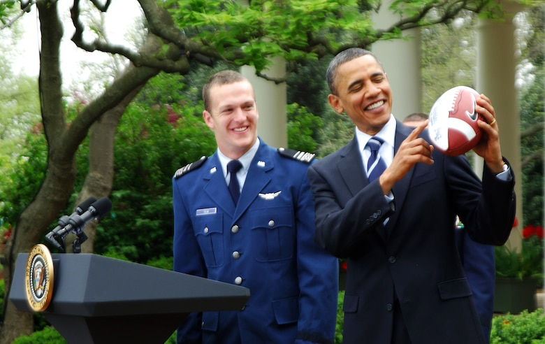 President Barack Obama receives a Falcons football from fullback Jared Tew after presenting the 2010 Air Force Academy football team with the Commander-in-Chief's Trophy at the White House Monday, April 18, 2011.  This is the 17th time the Falcons have won the trophy and the first since 2002.  (U.S. Air Force photo/Staff Sgt. Raymond Hoy)