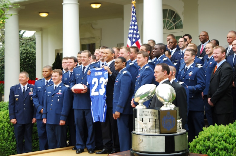 President Barack Obama poses with members of the 2010 Air Force Academy football team after presenting them with the Commander-in-Chief's Trophy at the White House Monday, April 18, 2011.  This is the 17th time the Falcons have won the trophy and the first since 2002.  (U.S. Air Force photo/Staff Sgt. Raymond Hoy)