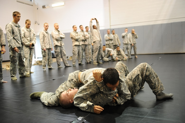 Tactial Air Control Party students test their new combatives skills on each other at Hurlburt Field, Fla., March 31, 2011. The TACPs adopted the new curriculum as part of the Air Force Combatives Program, initated January 2008. (U.S. Air Force photo by Airman 1st Class Caitlin O'Neil-McKeown/RELEASED)