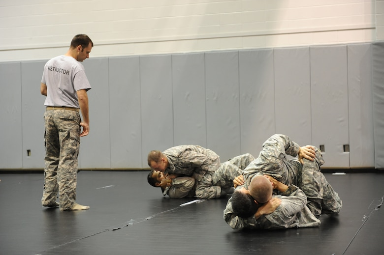 Tactical Air Control Party students demonstrate their newly gained combatives skills at Hurlburt Field, Fla., March 31, 2011. The TACP career field is the first to be introduced to the Air Force Combatives Program, initated January 2008. (Air Force photo by Airman 1st Class Caitlin O'Neil-McKeown/RELEASED)