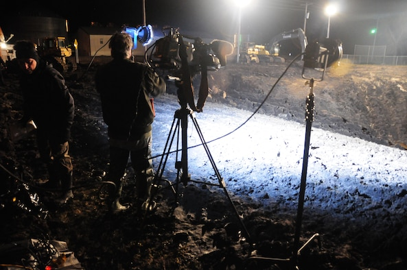 An ABC news crew records a live feed for Good Morning America's story on the 'Hole of Hope', in Georgetown, Minn. April 13, 2011.  Barbara Pinto, a news correspondent for ABC, reported from within the baseball field turned crater about how the town sacrificed the soil for levees to protect from Red River flooding in Minnesota.  (U.S. Air Force photo by Tech. Sgt. Brett R. Ewald)