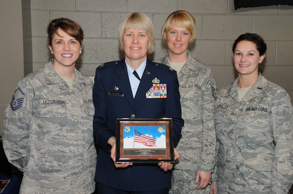 U.S. Air Force Col. Penny Dieryck, commander of the 148th Fighter Wing's Mission Support Group, poses with fellow airmen after accepting the Community Champion Award in Duluth, Minn., April 16, 2011. The Community Champion Award, presented by Dr. Anthony Macioce of Associated Chiropractic, was given to the 148 FW for continued unselfish commitment to serving the needs of the local community. (U.S. Air Force photo by Senior Airman Sarah C. Hayes)