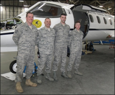 Members of the 103rd Maintenance Squadron's Inspection/Support Element, Master Sgt. Christopher Gagne, Tech. Sgt. Ryan Connoy, Staff Sgt. Paul Delgreco and Staff Sgt. Justin Lorentzen, also form up as the 103rd Maintenance Group's Crash, Damaged, Disabled Aircraft Recovery (CDDAR) Team. All are members of the Connecticut Air National Guard's 103rd Airlift Wing. (Photo courtesy of Maj. Wayne B. Ferris)