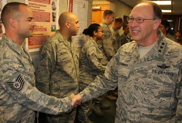 Lt. Gen. Charles  E. Stenner, Jr., commander of U.S. Air Force Reserve Command, shakes hands  with Tech. Sgt. Shannon Cook, before having breakfast with a small group of 932nd Airlift Wing reservists.  During his visit, General Stenner met with 932nd AW leadership and held a town hall meeting for reservists at the Scott Air Force Base theater.  (U.S. Air Force photo/Tech. Sgt. Dan Oliver)