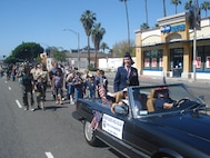"""Brig. Gen. Pamela Milligan, Vice-Commander, 4th Air Force, Air Force Reserve Command, March Air Reserve Base, Calif., rides in the 6th annual """"Salute to Veterans Parade"""" in downtown Riverside, Calif., April 16, 2011.  General Milligan was also a member of the reviewing party during the 132-unit parade, which was themed """"Honoring Those Who Have Sacrificed"""" and featured participants from military units from across southern California."""