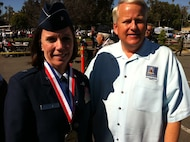 """Brig. Gen. Pamela Milligan, Vice-Commander, 4th Air Force, Air Force Reserve Command, March Air Reserve Base, Calif., poses with Riverside City Councilman Chris MacArthur at the 6th annual """"Salute to Veterans Parade"""" in downtown Riverside, Calif., April 16, 2011.  General Milligan was a member of the reviewing party during the 132-unit parade, which was themed """"Honoring Those Who Have Sacrificed"""" and featured participants from military units from across southern California."""