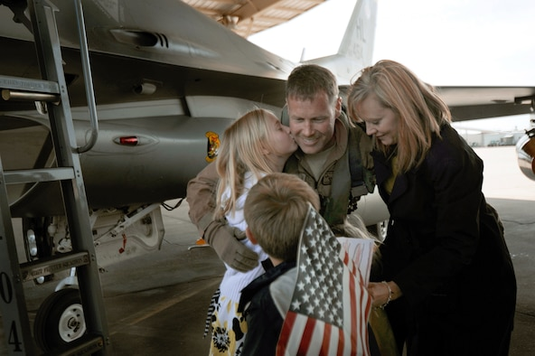 Col. William Bailey greets his wife and children upon his arrival April 15, 2011, at Hill Air Force Base, Utah. Colonel Bailey is the commander of the 4th Fighter Squadron and an F-16 Fighting Falcon pilot. He led six jets as the first of their team to return from a six-month deployment to Bagram Air Base, Afghanistan. (U.S. Air Force photo/Staff Sgt. Renae Saylock)