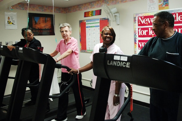 Men and women exercising on treadmills.