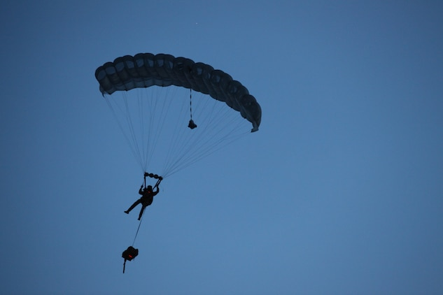 A Marine with 3rd Marine Special Operations Battalion, U.S. Marine Corps Forces, Special Operations Command, conducts a High Altitude, High Opening jump at dusk as part of a Double-Bag Static-Line parachute course in Wendover, Utah, April 9 - 21. The course was taught by personnel from the 2nd MSOB paraloft and the Airborne Mobile Training Team, and is designed to give Marines a basic understanding of HAHO operations.