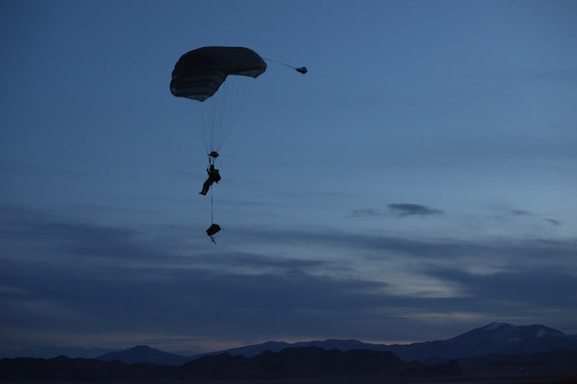 A Marine with 3rd Marine Special Operations Battalion, U.S. Marine Corps Forces, Special Operations Command, conducts a High Altitude, High Opening jump at dusk as part of a Double-Bag Static-Line parachute course in Wendover, Utah, April 9 - 21. The course was taught by personnel from the 2d MSOB paraloft and the Airborne Mobile Training Team, and is designed to give Marines a basic understanding of HAHO operations.