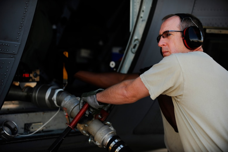 U.S. Air Force Tech. Sgt. Larry Quinn, 153th Aircraft Maintenance Squadron, Wyoming Air National Guard, prepares to remove a fire retardant hose from a C-130H Hercules equipped with the Modular Airborne Firefighting System at Dyess Air Force Base, Texas, April 19, 2011.  MAFFS is capable of dispensing 3,000 gallons of water or fire retardant in under 5 seconds.  Wildfires have spread across various parts of Texas and have burned more than 1,000 square miles of land.  (U.S. Air Force Photo/Staff Sgt. Eric Harris)