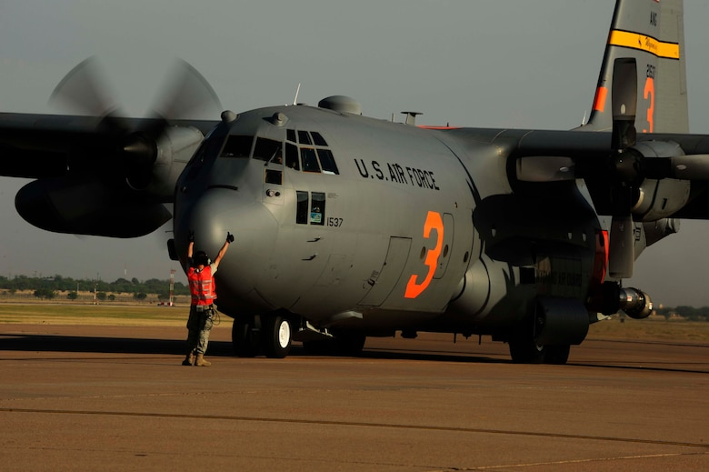 Master Sgt. Jeff Tschacher, 153rd Aircraft Maintenance Squadron, Wyoming Air National Guard, directs a C-130H Hercules equipped with the Modular Airborne Firefighting System(MAFFS) to start engine two in preparation to fight wildfires burning in Texas, Dyess Air Force Base, Texas, April 19, 2011. MAFFS is capable of dispensing 3,000 gallons of water or fire retardant in less than five seconds. The wildfires have spread across various parts of Texas and have burned more than 1,000 square miles of land.  (U.S. Air Force Photo by Staff Sgt. Eric Harris)