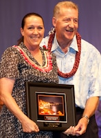 Colette Fisher (left), a budget technician with U.S. Marine Corps Forces, Pacific's Plans and Polices section, accepts the Federal Employee of the Year Award in the clerical and assistant category from the Honorable Peter Carlisle, mayor of the city and county of Honolulu, during the 55th Annual Excellence in Federal Government Awards Luncheon and Expo April 21 at the Sheraton Waikiki Hotel, here. The event was held to recognize federal employees for their contributions and excellence within their agency.