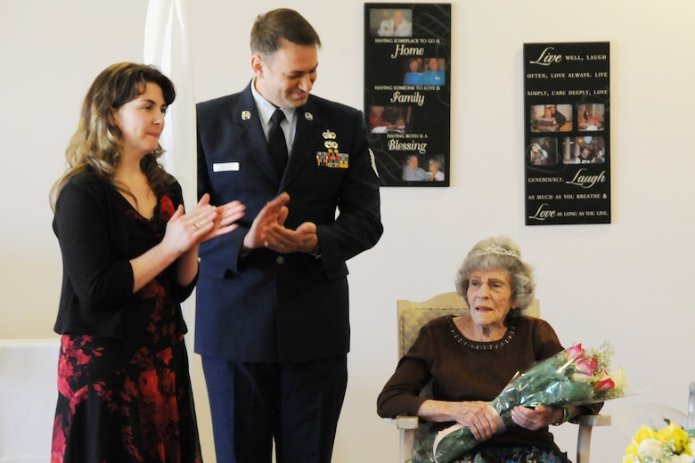 Tech. Sgt. Michael Shirar, 173rd Fighter Wing Maintenace Training Manager, and Tammy Smeed, Plum Ridge Marquis Care Activitites Director, clap for Mrs. Irene Dalton, the 2011 Rose Queen Princess, during the ceremony.  Members of the Oregon Air National Guard volunteered to help with the 2011 Rose Queen Corenation ceremony at Plum Ridge Marquis Care in Klamath Falls, Ore. April 8, 2011. (U.S. Air Force Photo by Tech.Sgt. Jennifer Shirar, RELEASED)