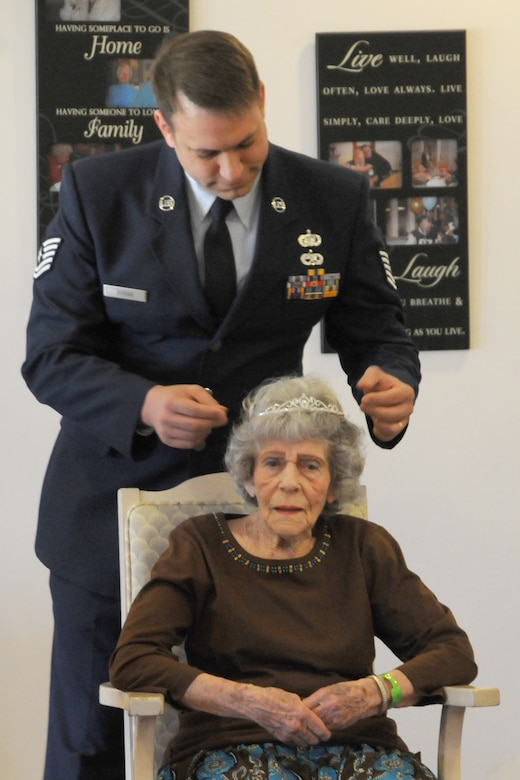 Tech. Sgt. Michael Shirar, 173rd Fighter Wing Maintenace Training Manager, places a tiara onMrs. Irene Dalton, the 2011 Rose Queen Princess, head during the ceremony.  Members of the Oregon Air National Guard volunteered to help with the 2011 Rose Queen Corenation ceremony at Plum Ridge Marquis Care in Klamath Falls, Ore. April 8, 2011. (U.S. Air Force Photo by Tech.Sgt. Jennifer Shirar, RELEASED)