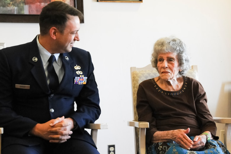 Tech. Sgt. Michael Shirar, 173rd Fighter Wing Maintenace Training Manager, talks with Mrs. Irene Dalton, one of the Rose Queen canidates, before the ceremony.  Members of the Oregon Air National Guard volunteered to help with the 2011 Rose Queen Corenation ceremony at Plum Ridge Marquis Care in Klamath Falls, Ore. April 8, 2011. (U.S. Air Force Photo by Tech.Sgt. Jennifer Shirar, RELEASED)