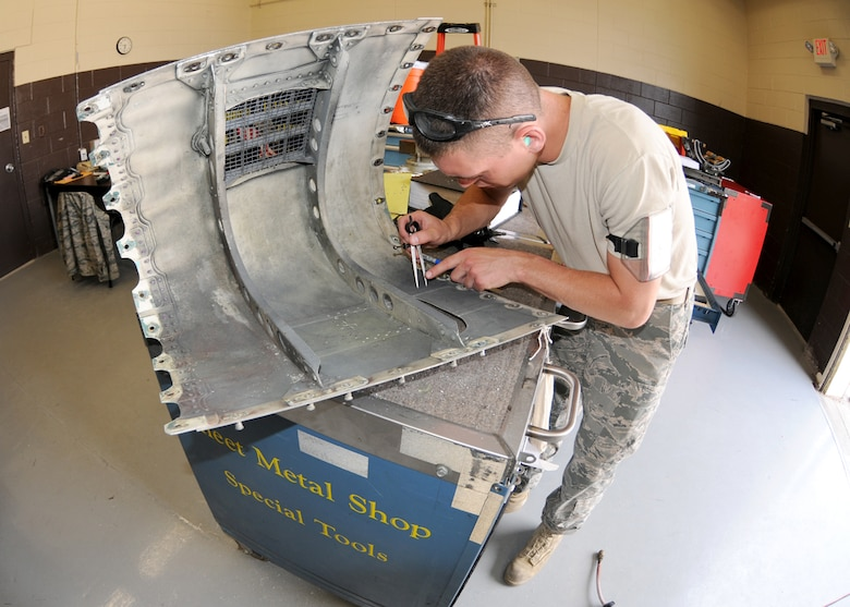 Staff Sgt.Nathan Poudrier from the Structural Maintenance shop 104th Fighter Wing Westfield Massachusetts, measure for a patch on the cracked gun panel at Tyndall Air Force Base, Fla on April 20, 2011.This gun panel was found cracked after on an F-15 aircraft after an exercise flight. While they are deployed to Tyndall Air Force Base in Florida, they are participating in the Weapons System Evaluation Program (WSEP).  (U.S. Air Force Photo by: Technical Sergeant, Melanie J. Casineau)