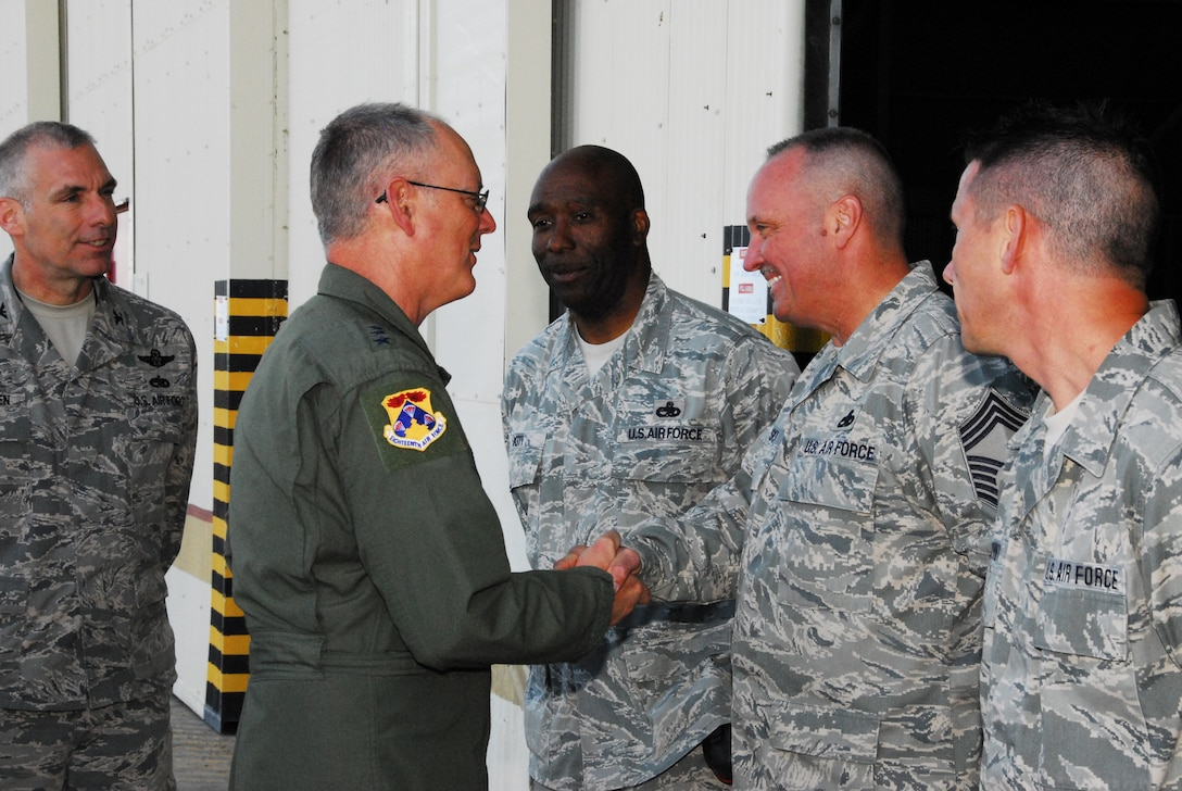 WESTERN EUROPE (April 15, 2011) -- The 313th Maintenace Expeditionary Group command staff greets Lt. Gen. Robert Allardice, commander of 18th Air Force during his visit April 15. The 313th AEW supports Operation Unified Protector, a NATO-led mission in Libya to protect civilian and civilian-populated areas under threat of attack. The 313th AEW provides aerial refueling to U.S. and coalition aircraft with KC-135 Stratotankers and KC-10 Extenders. (U.S. Air Force photo by Tech. Sgt. Stacy Gault/Released)