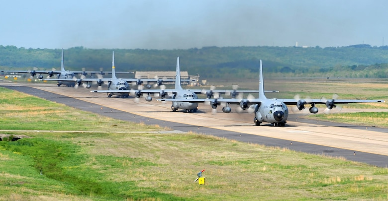 C-130's taxi April 14, 2011, at Little Rock Air Force Base, Ark., to take off from the base's runway during the combat surge week. The purpose of the surge week was to make up for lost flying time by increasing the operations tempo.  (U.S. Air Force photo by Airman 1st Class Rusty Frank)