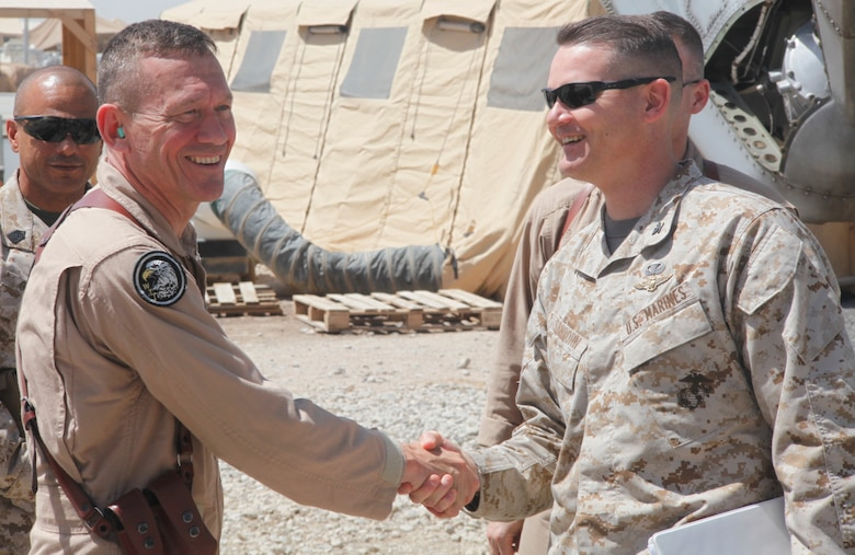 2nd Marine Aircraft Wing Commanding General Maj. Gen. Jon M. Davis greets Col. Russell A.C. Sanborn, the assistant wing commander of 2nd MAW (Forward), on the runway at Camp Bastion, Afghanistan, April 22. Davis visited Marine aviation squadrons deployed to Afghanistan in order to assess the needs of Marines and observe daily operations.