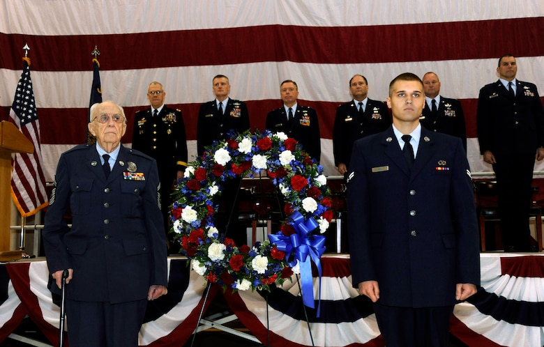 Oregon Air National Guard retired Chief Master Sgt. Jack Klein (left) and Airman 1st Class Elliot Gile, (right) participate in a wreath-laying ceremony during the Oregon Air National Guard's 70th Anniversary celebration at the Portland Air National Guard Base, in Portland, Ore., April 15, 2011.  Gile, a crew chief with the 142nd Fighter Wing, Oregon Air National Guard, is the newest member of the Oregon Air National Guard while Klein was the first Oregon Air National Guard recruiter and served with the 142nd Aircraft Control and Warning Squadron as a radar operator. (U.S. Air Force photograph by Tech. Sgt. John Hughel, 142nd Fighter Wing Public Affairs)