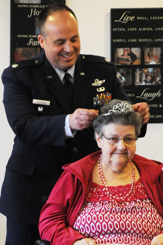 Lt. Col. Robert Erickson, State Director of Air Operations, crowns  Mrs. Joanne Hollenbeak the 2011 Rose Queen.  Members of the Oregon Air National Guard volunteered to help with the 2011 Rose Queen Corenation ceremony at Plum Ridge Marquis Care in Klamath Falls, Ore. April 8, 2011. (U.S. Air Force Photo by Tech.Sgt. Jennifer Shirar, RELEASED)