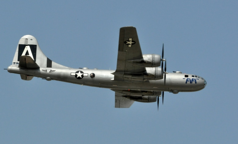 A World War II-era B-29 Superfortress bomber passes over Air Expo 2011, April 17, at Naval Air Station Fort Worth Joint Reserve Base, Texas.  More than 200,000 people were expected at the two-day airshow held April 16-17.  The B-29 is maintained and operated by the Commemorative Air Force.  (U.S. Air Force photo/Lt. Col. David Kurle)