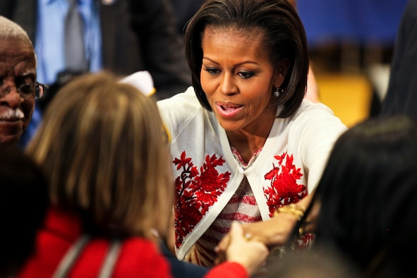 "First Lady Michelle Obama greets a member of the Camp Lejeune community April 13, 2011, during the ""Joining Forces"" campaign kickoff at Camp Lejeune, N.C. The White House launched the campaign to raise awareness about the challenges facing military families and to urge all Americans to support them. (U.S. Marine Corps photo/Lance Cpl. Damany S. Coleman)"