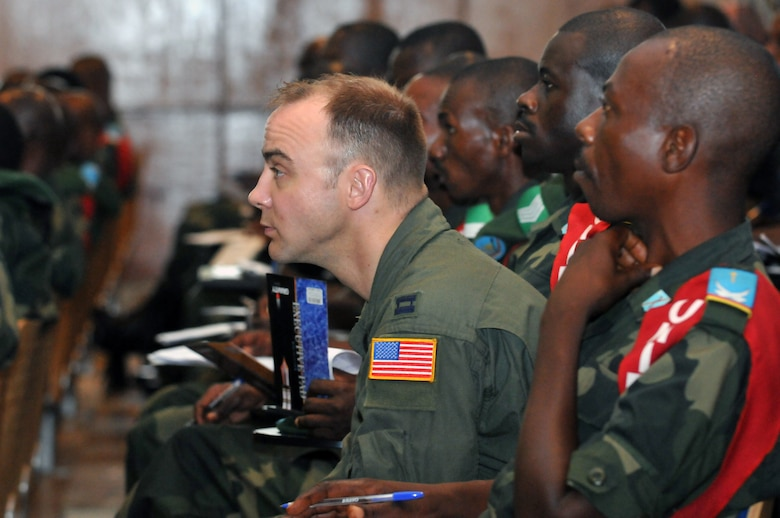 KINSHASA, Democratic Republic of the Congo -- U.S. Air Force Capt. Chris Wolf, a flight nurse with the Minnesota Air National Guard?s 133rd Airlift Wing listens to an academic lesson during MEDLITE 11, April 26, 2011. MEDLITE 11 is a joint medical exercise focused on aeromedical evacuation, to improve the readiness of U.S. Air Force and DRC personnel. (U.S. Air Force photo by Tech. Sgt. John Orrell)