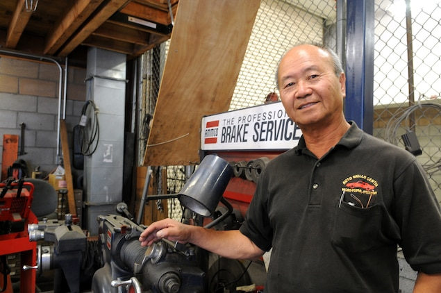 "King Wong poses next to machinery in the Marine Corps Air Station Auto Hobby Shop April 26, 2011. After 16 years as the shop's manager, Wong's auto hobby center was recognized as one of the best auto shops in the Corps before he retires July 15, 2011. ""He has done a lot of innovative things at the hobby shop, far above what is expected of him. We really hate to see him go. The next guy has big shoes to fill,"" said David Rodriguez, station environmental director."