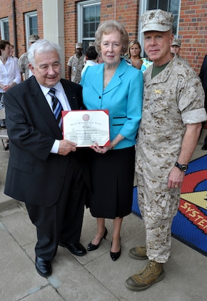 General James Amos, Commandant of the Marine Corps, presents Dick and Marguerite Govoni with a certificate representing Dick's 60 years of service to the Marine Corps, both as an active-duty Marine and a Civilian Marine. Govoni works in Marine Corps Systems Command's Life Cycle Logistics office.