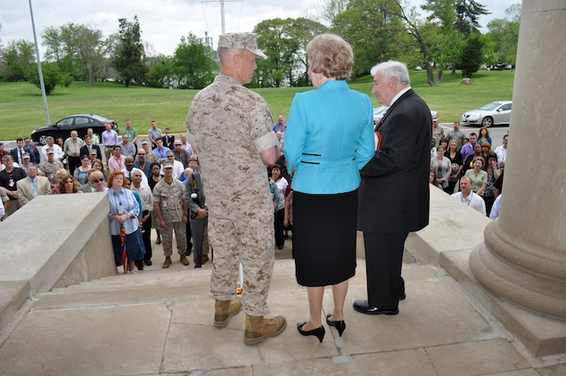 Members of Marine Corps Systems Command witness General James Amos, Commandant of the Marine Corps, presenting Dick and Marguerite Govoni with a coin during an event celebrating Dick's 60 years of service to the Marine Corps.