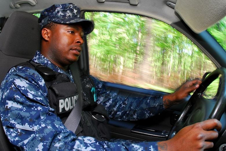 JOINT BASE CHARLESTON, S.C. (April 20, 2011) Master-at-Arms 2nd Class Sherman Whidbee, a patrolman for the 628th Security Forces Squadron, conducts a routine patrol of Marrington Plantation during his shift at Joint Base Charleston-Weapons Station, April 20.  (U.S. Navy photo/Machinist's Mate 3rd Class Brannon Deugan)
