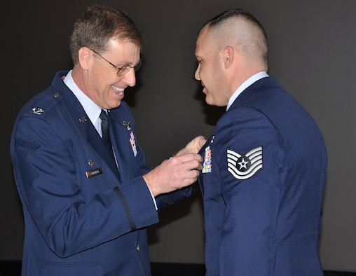 WRIGHT-PATTERSON AIR FORCE BASE, Ohio – Col. Stephen Goeman, 445th Airlift Wing commander, pins the Bronze Star on Tech. Sergeant Jason Hutchison, 445th Aeromedical Evacuation Squadron, during the April 3 unit training assembly.  Sergeant Hutchison was awarded the Bronze Star while he was serving in the Army and was assigned as a platoon sergeant, First Platoon, 342nd Military Police Company, multi-National Corps-Iraq, Baghdad, Iraq, from Oct. 25, 2008, to Sept. 30, 2009, in support of Operation Iraqi Freedom. (U.S. Air Force photo/Senior Airman Shenchia Chu)