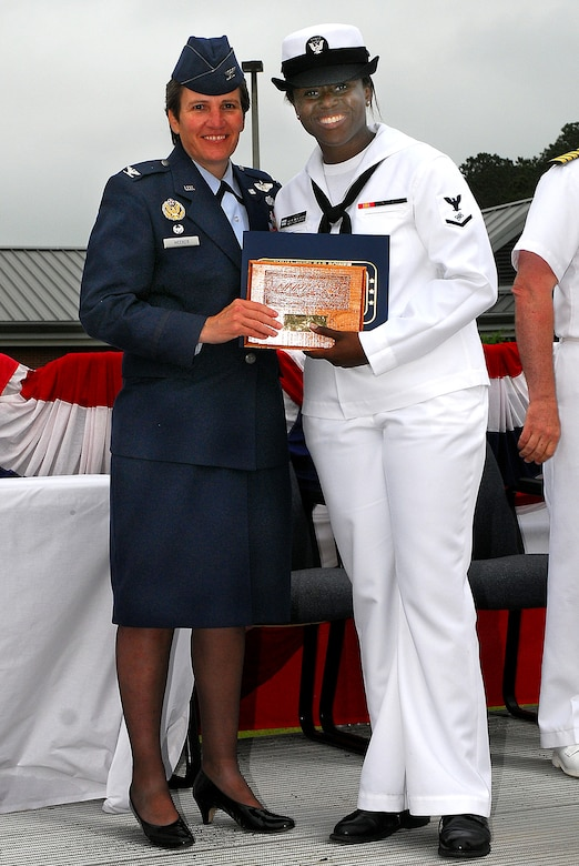 JOINT BASE CHARLESTON, S.C. (April 22, 2011) Electronics Technician 3rd Class Ashley Gray receives the enlisted honor man plaque, awarded to the highest grade-point-average for the enlisted class, from Col. Martha Meeker during the Navy Nuclear Power Training Command graduation ceremony for class 1101 at Joint Base Charleston-Weapons Station, April 22.  ET3 Gray earned an overall GPA of 3.90. Colonel Meeker is the Joint Base Charleston commander. (U.S. Navy photo/Machinist's Mate 3rd Class Brannon Deugan)