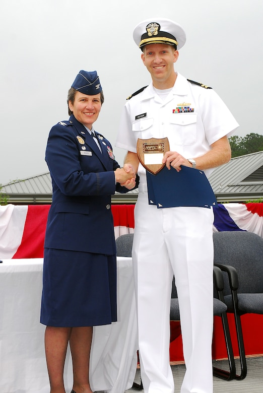 JOINT BASE CHARLESTON, S.C. (April 22, 2011) Lt. Gregory Dietzen receives the Vice Adm. Behrens award plaque, awarded to the graduating officer with the highest grade-point-average, from keynote speaker Col. Martha Meeker during the Navy Nuclear Power Training Command graduation ceremony for class 1101 at Joint Base Charleston-Weapons Station, April 22.  Lieutenant Dietzen earned an overall GPA of 3.91. Colonel Meeker is the Joint Base Charleston commander. (U.S. Navy photo/Machinist's Mate 3rd Class Brannon Deugan)