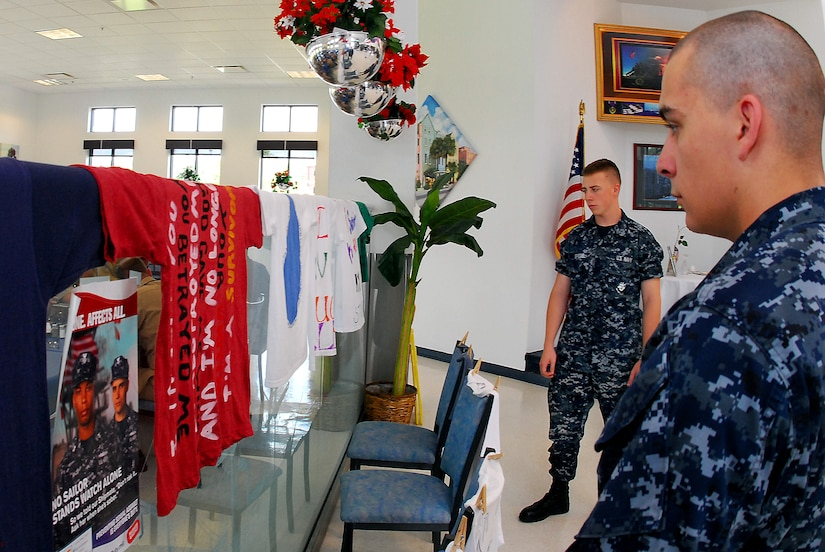 JOINT BASE CHARLESTON, S.C. (April 25, 2011) Machinist's Mate Fireman Jeffry Spiegel (left) and Machinist's Mate Fireman Edward Knox, of Detaching Transient Personnel, look over the sexual assault awareness clothesline at the Weapons Station galley at Joint Base Charleston-Weapons Station, April 25.  The clothesline displays t-shirts designed by survivors of a sexual assault, bringing a creative voice to stand out against sexual violence and to raise awareness throughout the JB CHS-WS community. (U.S. Navy photo/Machinist's Mate 3rd Class Brannon Deugan)