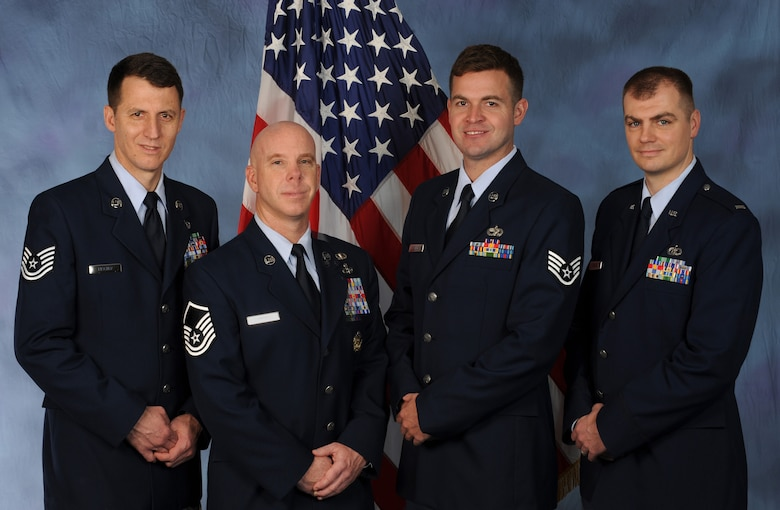 Members of the Oregon Air National Guard's 123rd Weather Flight were recently recognized with the U.S. Air Force's Outstanding Technical Achievement in Weather Operations Award. From left to right are: Tech. Sgt. Michael Fischer, Master Sgt. Ken Campbell, Staff Sgt. Matt Jenkins, and Lt. Mark Gibson. The four Airmen volunteered for a six-month duty in Haiti following the devastating earthquake there, in January, 2010.  (U.S. Air Force photograph by Tech. Sgt. John Hughel, 142nd Fighter Wing Public Affairs).