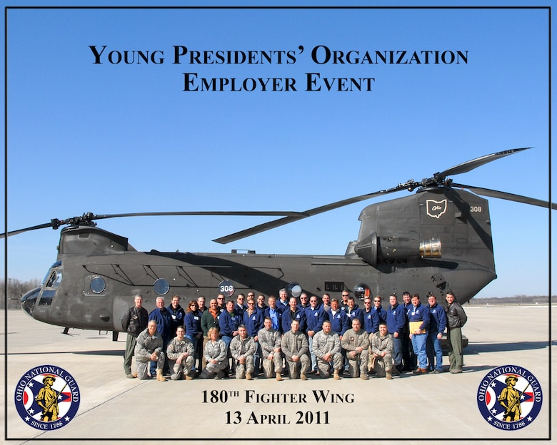 Members of the Young Presidents Organization pose for a group photo at the 180th Fighter Wing, Ohio, April 13. These young presidents and CEOs of local businesses spent the day learning about Ohio Army and Air National Guard missions and the benefits of employing members of the National Guard. They spent the morning at the 180th leaning about the 180th and Air National Guard before taking a short flight on a Chinook Helicopter to Camp Perry in Port Clinton, OH where the group enjoyed an MRE lunch before learning about Army Guard operations.