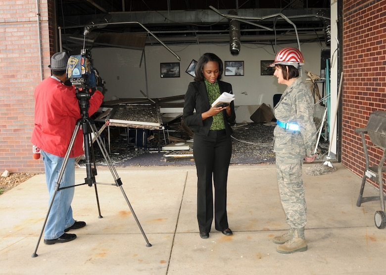 Colonel Kathleen Hancox, 131st Mission Support Group Commander and Emergency Operations Center Director, is interviewed by Ms. Courtney Gousman, a broadcast journalist with KSDK News Channel 5, regarding continued cleanup efforts at the 131st Bomb Wing Missouri Air National Guard Base at Lambert Field-Saint Louis, April 26.  A category EF4 tornado swept across the Base, April 22. No injuries were reported to Air National Guard personnel, but there was widespread damage across the south-side of the base. Estimates for repair to the base could top 10 million U.S. dollars.  Cleanup efforts at the base are ongoing. (Photo by Master Sgt. Mary-Dale Amison)