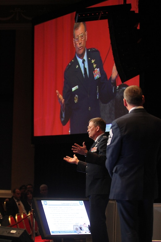 Maj. Gen. Richard Webber, 24th Air Force commander, speaks at the 27th National Space Symposium held at the Broadmoor Resort in Colorado Springs, Colo., April 11. General Webber and Chief Master Sgt. Kevin Slater, the unit's command chief (foreground), defined cyber operations, the Air Force's methods of operating in cyberspace, the joint environment, the importance of an operational mindset, training, education and more during the symposium's Cyber 1.1 event. (Courtesy photo provided by the Space Foundation)