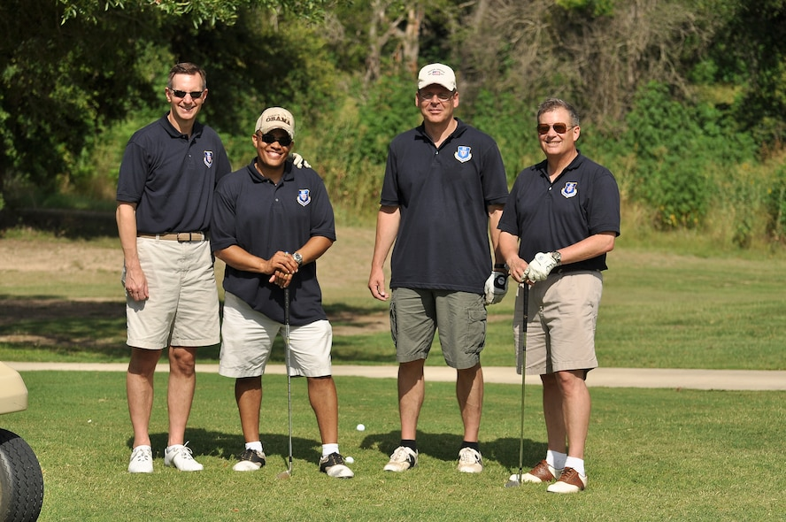 Maj. Gen. Richard Webber, 24th Air Force commander, (right) stands with others from the numbered air force command section during the inaugural 24th Air Force golf tournament in 2010. There were a lot of firsts in General Webber's career. Also in this photo, from left to right, are Brig. Gen. Charles Shugg, 24th Air Force vice commander, Capt. Charlie Boyd, 24th Air Force aide-de-camp, and Chief Master Sgt. Kevin Slater, 24th Air Force command chief. (U.S. Air Force photo by Master Sgt. Eddie Moore)