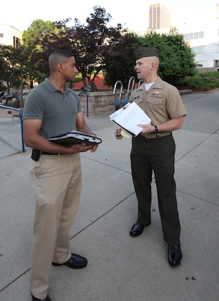 Capt. Ben Roy, an instructor with The Basic School, Marine Corps Base Quantico, Va., introduces himself to Georgia State University student Kris Embry on April 29 and discusses upcoming events for Marine Corps Leadership Seminar - Atlanta. The inaugural event brought together senior Marine leaders and administrators, professors, and students from Atlanta-area colleges and universities for a two-day, hands-on seminar focused on Marine Corps leadership development.