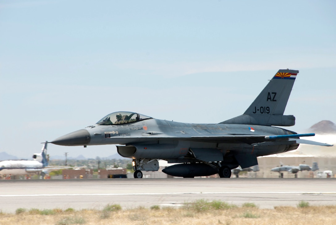 Lt. Daniel, a student pilot from the Royal Netherlands Air Force, takes off in an F-16 Fighting Falcon at Tucson International Airport, April 28. The 162nd Fighter Wing here trains Dutch fighter pilots in Dutch-owned F-16 Mid-Life Update aircraft - essentially early-model F-16A/B's that have undergone cockpit and avionics upgrades that make them as capable as the newer C/D-models. Lt. Daniel's last name is omitted for security purposes. (U.S. Air Force photo/Master Sgt. Dave Neve)