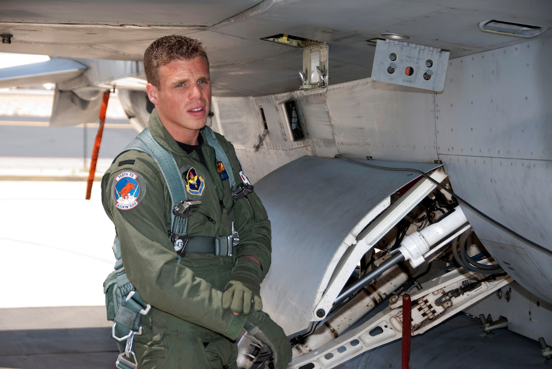 Lt. Daniel, a student F-16 pilot from the Royal Netherlands Air Force, performs a pre-flight check on the 162nd Fighter Wing flightline, April 28. He's one of the first Dutch students to train in Tucson since the RNLAF program was re-introduced at the wing in January. The Dutch previously trained with the wing from 1989 through 2007. Lt. Daniel's last name is omitted for security purposes. (U.S. Air Force photo/Master Sgt. Dave Neve)