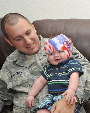 Cutline: Staff Sgt. James Starcher plays with his son Bryson at their home April 22. Assistance from the Air Force Aid Society has helped the Starcher family pay for Bryson's medical care. Sergeant Starcher is with the 802nd Logistics Readiness Squadron. (U.S. Air Force photo/Alan Boedeker)