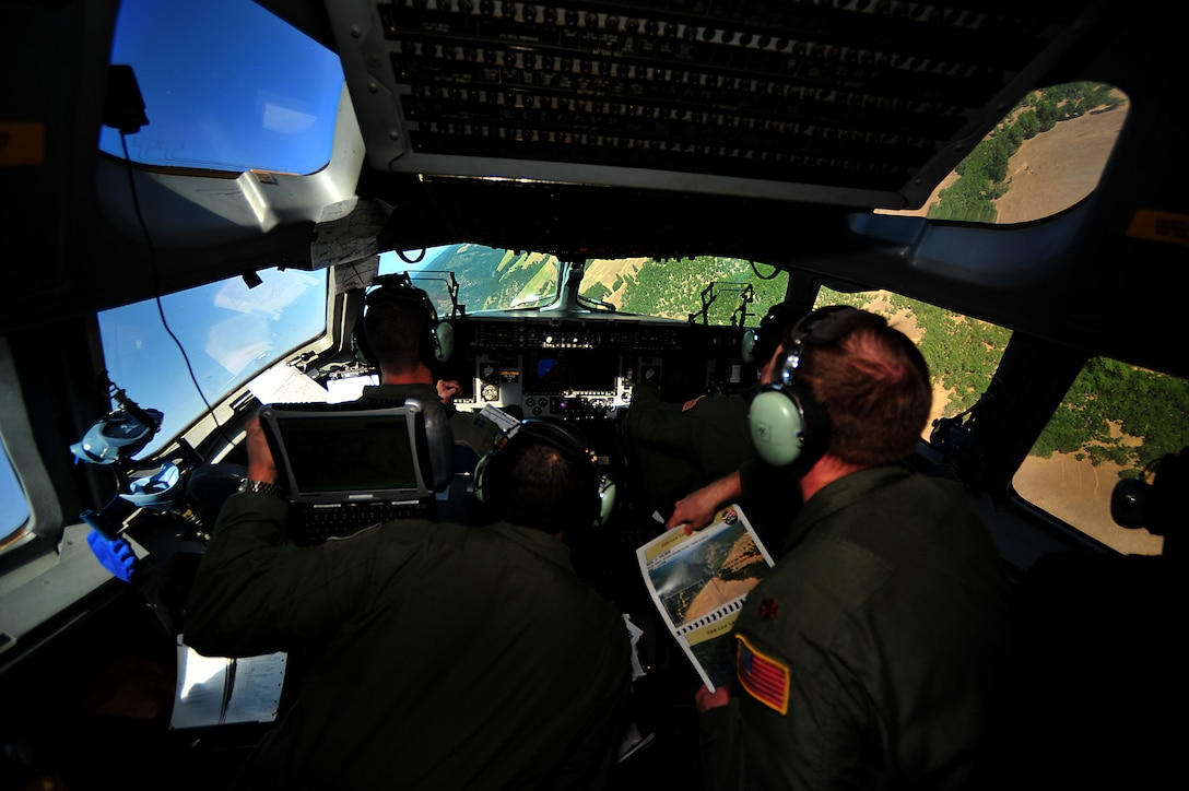 Crew members from Joint Base Pearl Harbor-Hickam, Hawaii, perform low-level maneuvers in a C-17 during a 2011 Air Mobility Rodeo contest at Joint Base Lewis-McChord, Wash., July 27. Air Mobility Rodeo is the U.S. Air Force's and Air Mobility Command's premier international combat skill and flying operations competition designed to develop and improve techniques, procedures and interoperability, while optimizing international mobility partnerships and enhancing mobility operations. (U.S. Air Force photo/Staff Sgt. Nicholas Pilch)