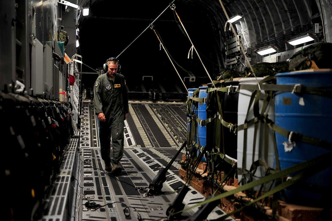 U.S. Air Force Master Sgt. Tim Ledford, a loadmaster from Joint Base Pearl Harbor-Hickam, Hawaii, preps a C-17 Globemaster III before a contest during Air Mobility Rodeo 2011 at Joint Base Lewis-McChord, Wash., July 27. Air Mobility Rodeo is the U.S. Air Force's and Air Mobility Commandís premier international combat skill and flying operations competition designed to develop and improve techniques, procedures and interoperability, while optimizing international mobility partnerships and enhancing mobility operations. (U.S. Air Force photo/Staff Sgt. Nicholas Pilch)