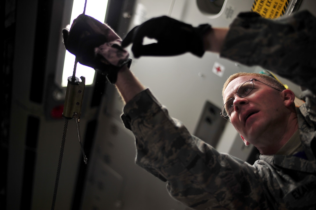 Master Sgt. Mike Evans, a crew chief from Joint Base Pearl Harbor-Hickam, Hawaii, prepares a C-17 Globemaster III before a contest at Air Mobility Rodeo 2011 at Joint Base Lewis-McChord, Wash., July 27. Air Mobility Rodeo is the U.S. Air Force's and Air Mobility Command's premier international combat skill and flying operations competition designed to develop and improve techniques, procedures and interoperability, while optimizing international mobility partnerships and enhancing mobility operations. (U.S. Air Force photo/Staff Sgt. Nicholas Pilch)
